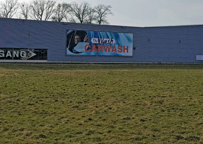 The Wash Hengelo Buizenframe met Banner Outdoorsigning